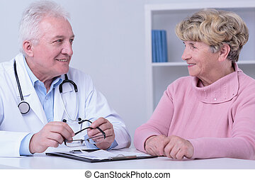 Smiling patient and doctor