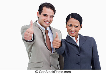Smiling salespeople giving thumbs up against a white background