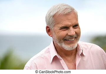 Smiling senior outdoors