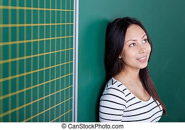 smiling teenage girl in school looking up