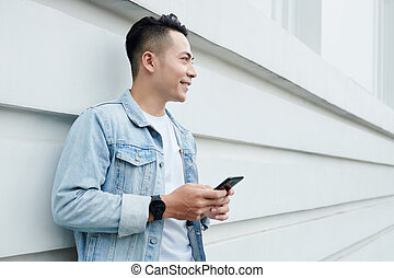 Smiling Vietnamese Man with Smartphone