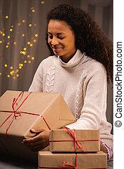 Smiling woman holding big present