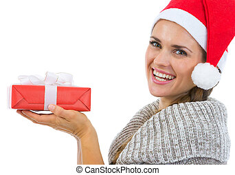 Smiling woman holding Christmas present