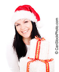smiling woman in christmas clothes holding present over white