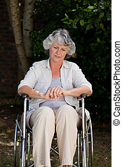 Smiling woman in her wheelchair