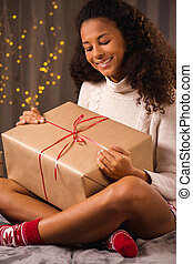 Smiling woman looking at present