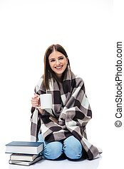 Smiling young woman sitting with cup of coffee
