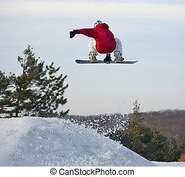 Snowboarder Launching Big Air