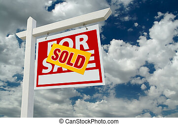Sold For Sale Real Estate Sign on Clouds