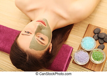 Spa. Care Facial. Beautiful young woman relaxing in the spa salon
