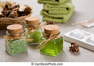 Aromatherapy products and candles on table