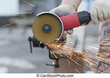 Sparks flying metal cutting abrasive disk.