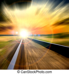 Speed blurred railroad into the sunset