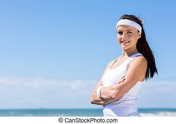 young fitness woman with arms crossed