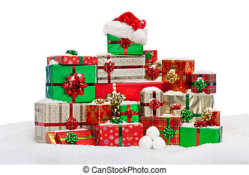 Stack of gift wrapped Christmas presents on snow