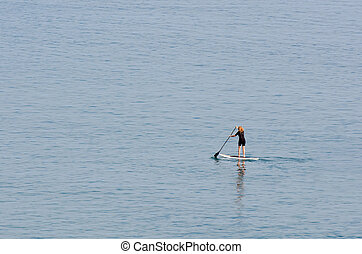 Stand up paddle surfing