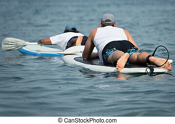 Stand up paddle two surfer