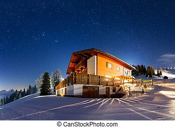 Magnificent panorama of a house on the mountain with a lot of stars at night