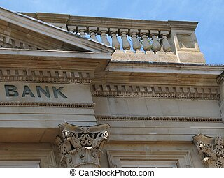 stone building with carved word bank