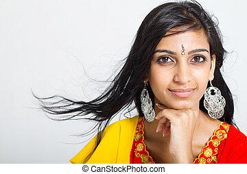 studio portrait of a beautiful indian woman