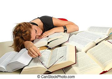 Blonde girl studying between big books