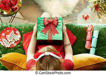 stylish little princess holding Christmas present box