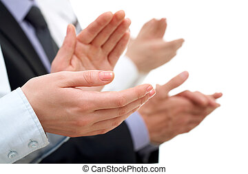 Photo of businesswoman?s hands applauding at meeting