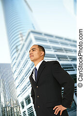 an architect or designer or business owner standing by tall contemporary office building