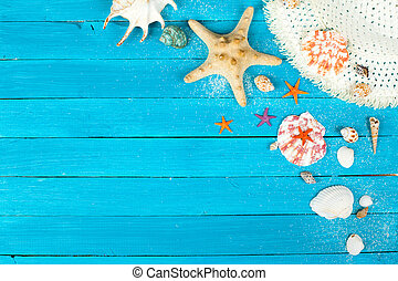 Summer accessories on blue wooden background. studio shot