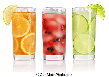 Summer drinks with ice, fresh berries, lemon and lime isolated on white