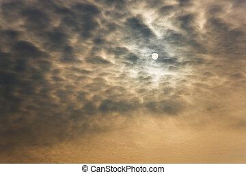 Sun in cloudy sky