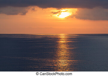 sunrise at ocean seascape with reflection