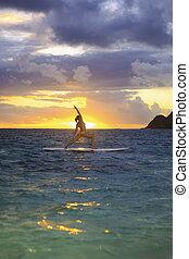 sunrise yoga on paddleboard