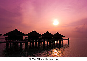 Sunset and water bungalows