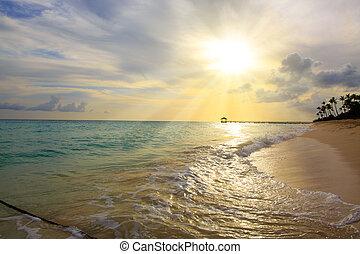 Sunset on the beach of caribbean sea.