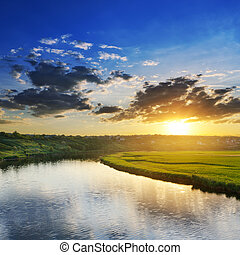 sunset over river