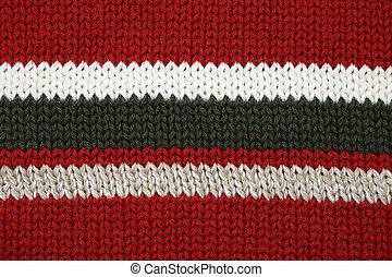 Red, black, tan, white, sweater fabric detail.
