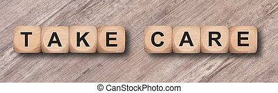take care written on wooden cubes