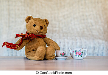 Teddy bear having tea