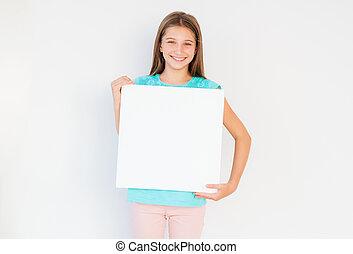 Teen girl holding blank canvas
