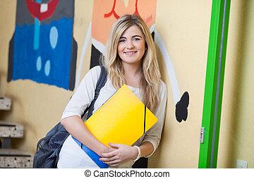 Teenage Girl Leaning On School Wall