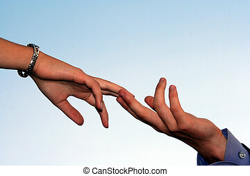 A man's hand and woman's hand touching each other