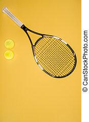 Tennis racket with balls isolated on yellow