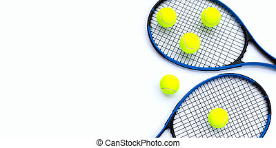 Tennis rackets with balls on white.