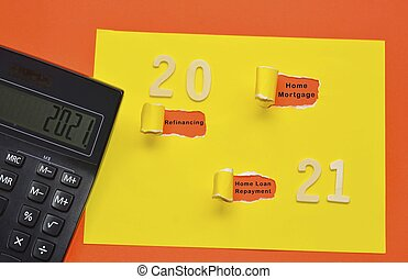 Text on colorful torn paper with Year 2021 and black calculator background