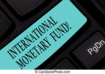 Text sign showing International Monetary Fund. Conceptual photo promotes international financial stability Keyboard key Intention to create computer message pressing keypad idea.