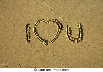text written in sand: I LOVE YOU, heart