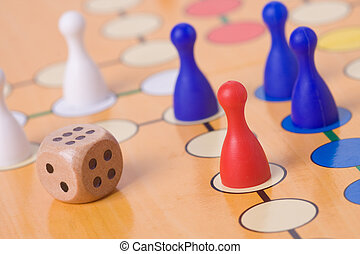 the board game with color pawns