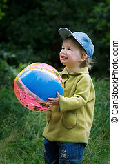 The cheerful kid with a ball