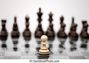 A pawn on the chequer before the shapes.